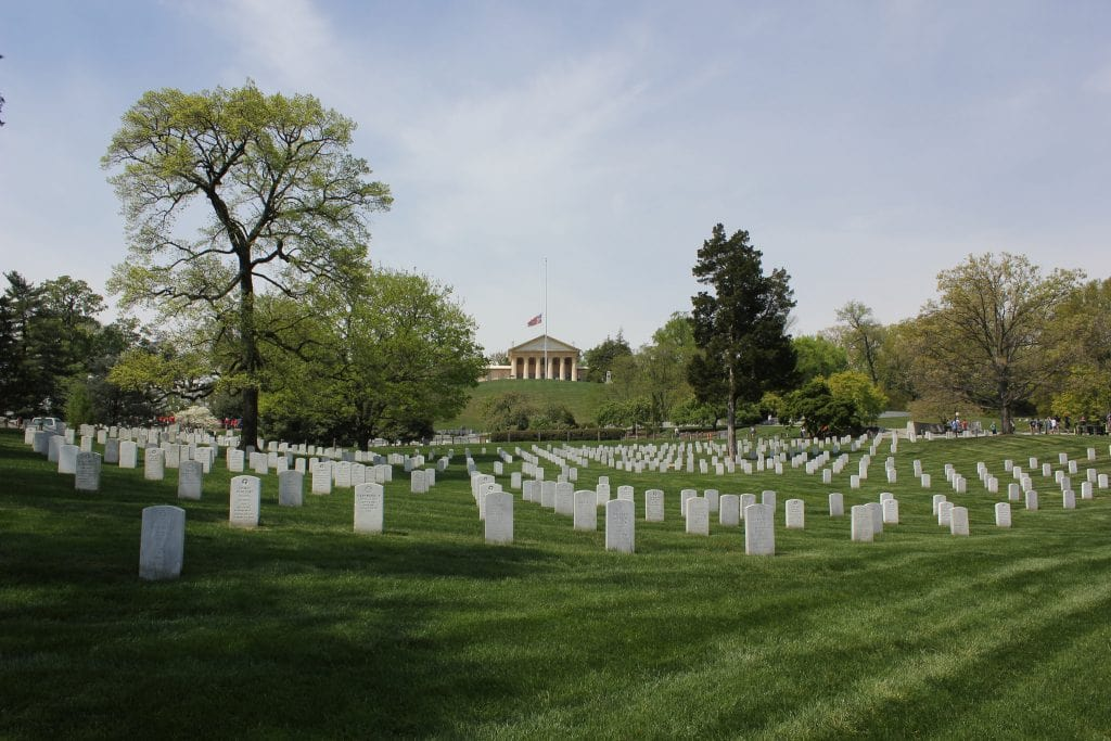 """Arlington National Cemetery"" (https://www.flickr.com/photos/texasbackroads/29684865885/in/photolist-Me9Gqv-BdwLYh-vGUCoP-ei63Kn-dPUbNu-7LKJTb-b8TeRP-GXbLmb-cMseW5-nbhowB-cVAJQb-2BMxj-7LhhCm-dMr1t2-eHnCw7-7QXbe9-oj5pqq-ehezxm-nozmhT-fmzuvA-fmjviZ-7LFN78-ps7V9V-oAnntU-7VwYmx-6ioW2A-nZ2NwT-fmzrZb-fmjJnc-fmjVmR-bcGqvK-bGfvw6-7Vi3PV-9dyRHW-9jmSqQ-Fx1J4N-fmyGDu-7LdiLi-8bdQM4-bKthsB-fmyAq7-7V4D18-c7K8PA-nbTi2x-8TTDBe-dq8Cov-7Vghmx-CXx7hH-ai5SZV-c7Fnwd) by Nicolas Henderson (https://www.flickr.com/photos/texasbackroads/) is licensed under CC BY 2.0 (https://creativecommons.org/licenses/by/2.0/)"